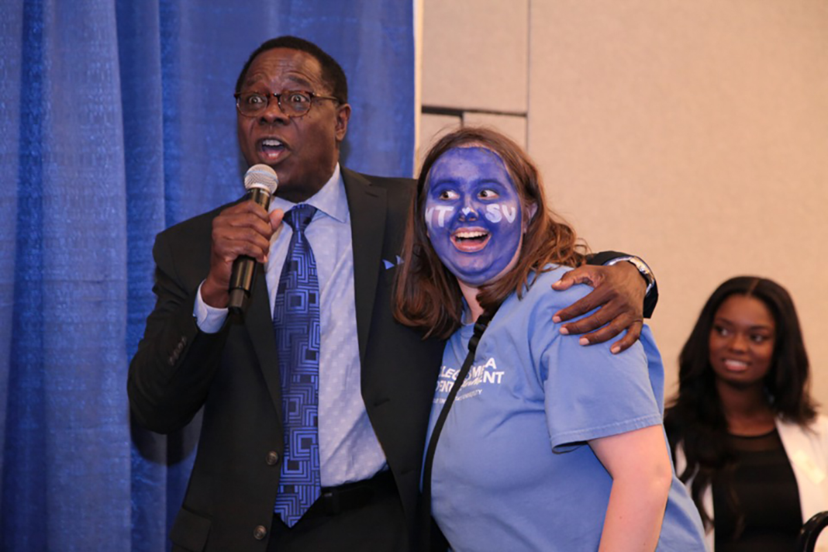 MTSU President Sidney A. McPhee, left, carries on with Sallie Rawlston of Soddy-Daisy, Tenn., Tuesday, Oct. 29, during the annual True Blue Tour event at the Chattanooga Convention Center. She received a combined $8,500 in scholarships from the university. (MTSU photo by John Goodwin)