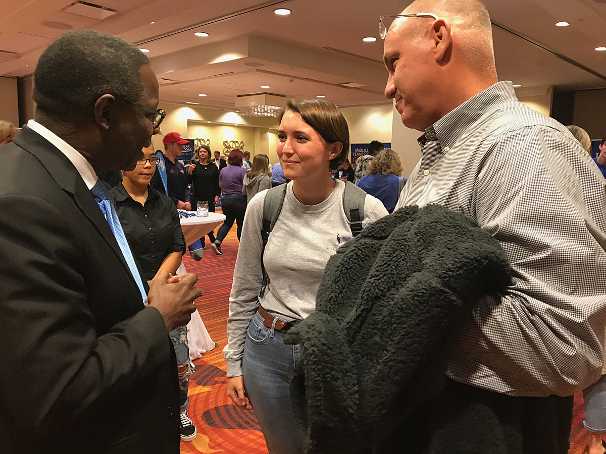 MTSU President Sidney A. McPhee, left, visits with Olivia Porter and her father, Dusty Porter, both of Fort Thomas, Ky., Wednesday, Oct. 16, during the True Blue Tour event to recruit prospective students in Louisville, Ky. (MTSU photo by Randy Weiler)