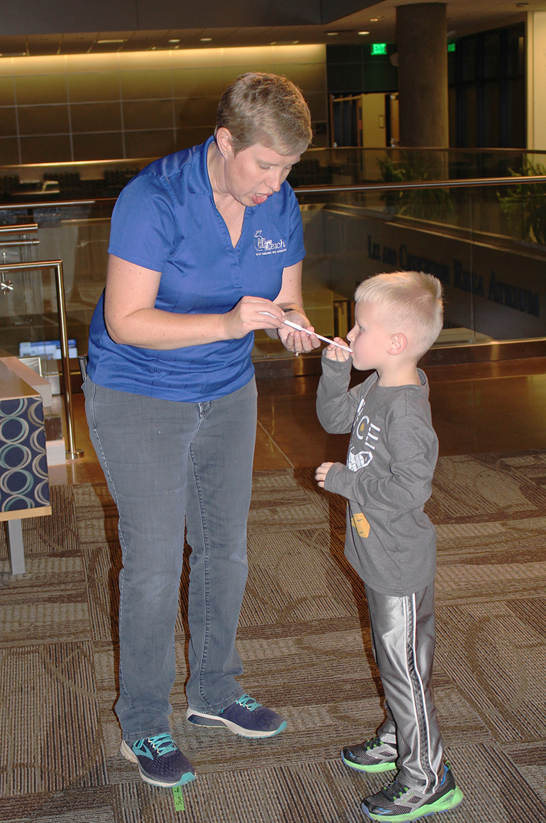 "MTSU MTeach program instructor Sally Millsap, left, helps her son, Joe, now 6, launch a paper rocket with a straw during the Tennessee STEAM Festival's October Sky Family Movie Night in October 2018. This year, the free College of Basic and Applied Sciences and MTeach ""Charlotte's Web"" movie and activities will be held from 5:30 to 8 p.m. in the Science Building, 440 Friendship St. (Submitted photo)"