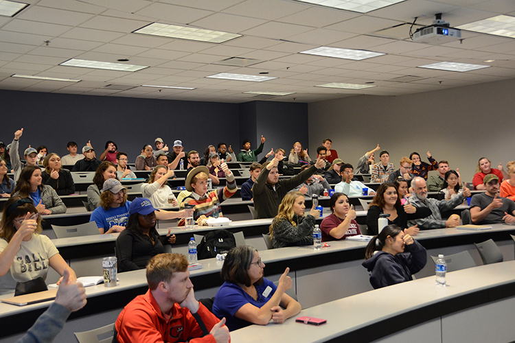 MTSU management students respond to a question from social entrepreneur and author Matt Tenney, who was giving a guest lecture about the value of servant leadership Thursday, Oct. 17, inside the Business and Aerospace Building classroom. (MTSU photo by Jimmy Hart)