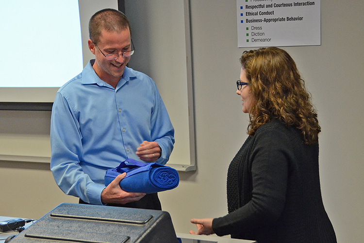Social entrepreneur and author Matt Tenney, left, accepts a thank you gift from assistant professor Kristie Abston following Tenney's guest lecture on the value of servant leadership to MTSU management students Thursday, Oct. 17, inside the Business and Aerospace Building classroom. (MTSU photo by Jimmy Hart)