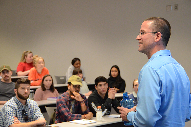 Social entrepreneur and author Matt Tenney talks to MTSU management students about the value of servant leadership during a guest lecture Thursday, Oct. 17, inside the Business and Aerospace Building classroom. (MTSU photo by Jimmy Hart)