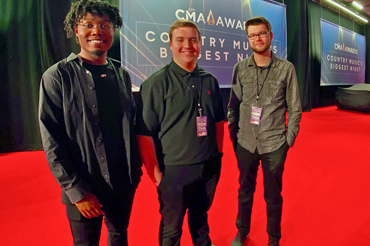 A group of MTSU media arts students helped with the production and telecast of the 53rd annual Country Music Awards held recently at Bridgestone Arena in Nashville, Tenn. Pictured inside the arena, from left, are students Kendrick Howard, Dakota Russ and Seth Sanders. (Submitted photo)