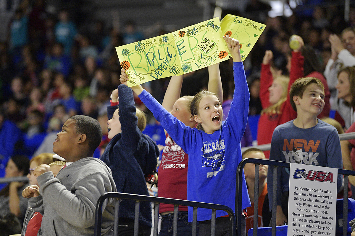 Emily Nelson, holding the hand-made Blue Raiders sign, cheers on MTSU Tuesday, Nov. 5, in Murphy Center. She and others in her section are fifth-graders at Lascassas Elementary School. MTSU beat Maryville College, 119-61, in the season opener in the annual Rutherford County Schools' Day. (MTSU photo by Andy Heidt)