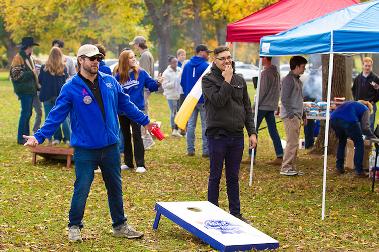 In this 2018 photo, MTSU students relax as they play Cornhole and tailgate in Walnut Grove, hours before the Blue Raiders play rival Western Kentucky. (MTSU file photo by James Cessna)