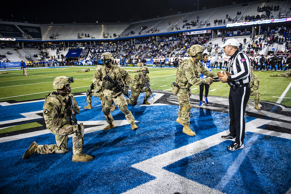 Soldiers from the U.S. Army's Fort Campbell installation delivered the game ball to officials on the field in November 2018 during the 37th annual Salute to Veterans and Armed Forces game. Twenty-two soldiers flew by helicopter, which landed on the football practice field. (MTSU file photo by Eric Sutton)