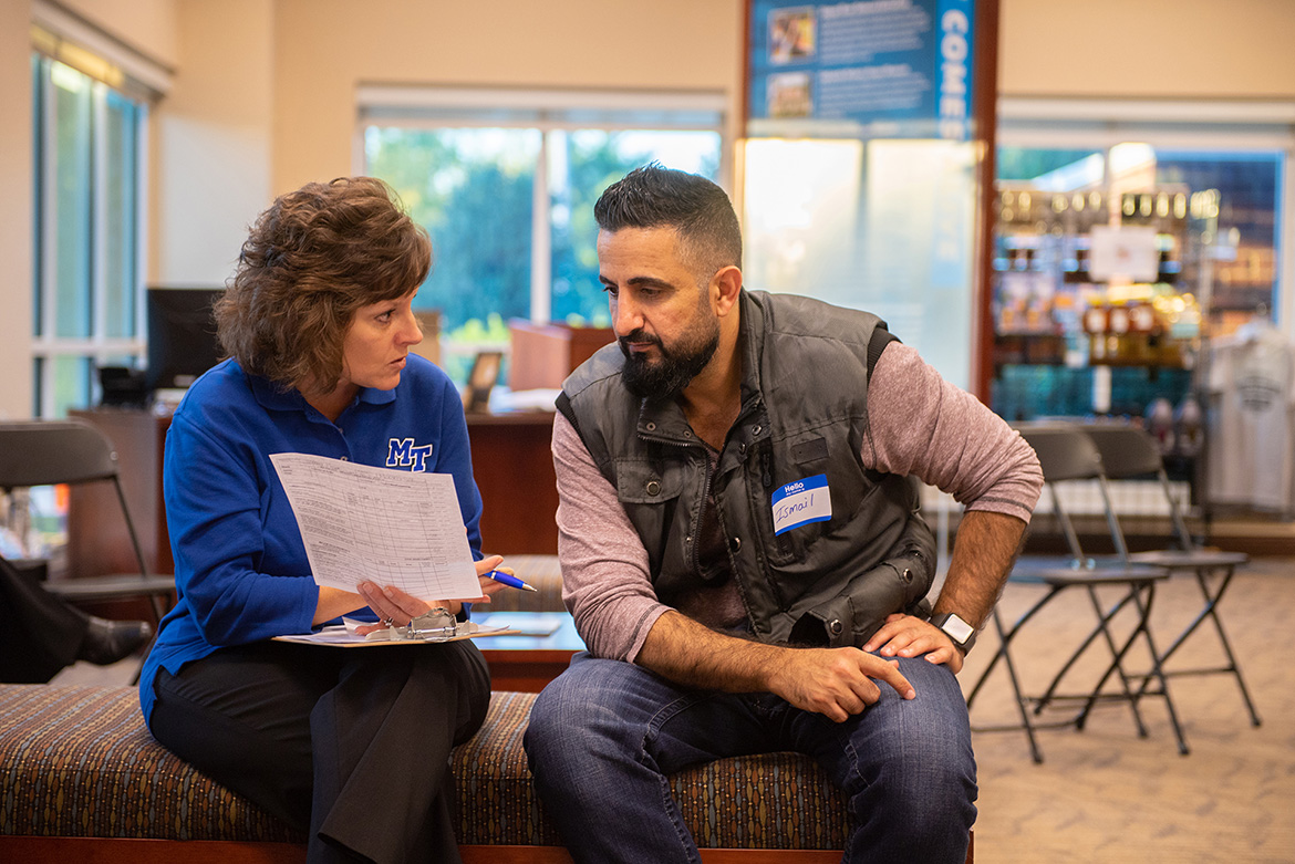 Dianna Rust, a professor in University Studies for MTSU's University College, talks with a prospective student at the Finish Your Degree Q and A event held Oct. 23 at the Rutherford County Chamber of Commerce in Murfreesboro, Tenn. (MTSU photo by Hunter Patterson)