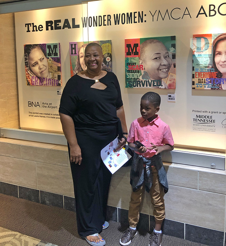 "Breast cancer survivor Monica McGuire is shown with family friend Harper Fields at the Nashville International Airport in September for a special reception featuring the exhibit of MTSU visual arts professor Leslie Haines, also a breast cancer survivor and who created a series of 12 portrait illustrations of fellow survivors titled ""The Real Wonder Women: YMCA ABC Program"" that will be on display in Concourse A of the airport until late February. (Submitted photo)"
