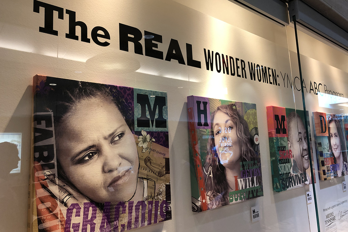 """The Real Wonder Women: YMCA ABC Program"" exhibit wall is shown at Nashville International Airport. Leslie Haines, a visual communication professor in the MTSU School of Journalism and Strategic Media and breast cancer survivor, created a series of 12 portrait illustrations of fellow survivors who participated in the YMCA program. The exhibit will be on display until late February. (Submitted photo)"