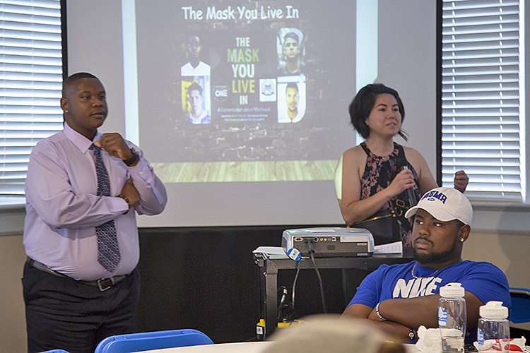 "Kelly Hill, right, Power of One prevention coordinator with the June Anderson Center for Women and Nontraditional Students, facilitates ""The Mask You Live In: A Conversation on Manhood"" discussion in late September inside the Tom Jackson Building with Travis Strattion, left, assistant manager with the Scholars Academy. (Submitted photo)"