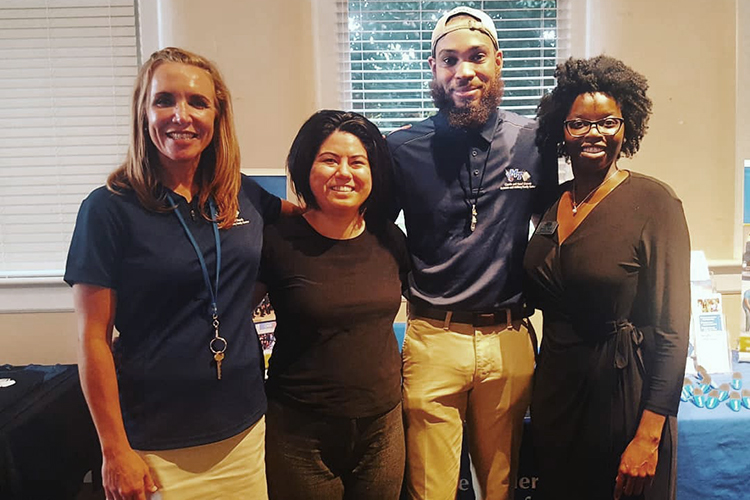 Kelly Hill, second from left, Power of One prevention coordinator with the June Anderson Center for Women and Nontraditional Students, poses with representatives from the Charlie and Hazel Daniels Veterans and Military Family Center, one of her campus partners. (Submitted photo)