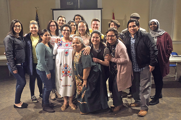 Kelly Hill, front row, fourth from left, Power of One prevention coordinator with the June Anderson Center for Women and Nontraditional Students, is pictured with members and supports of the La Communidad student organization in this undated photo. (Submitted photo)