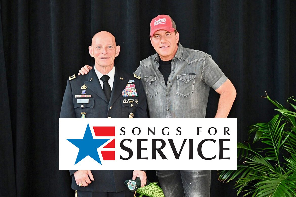 MTSU veterans adviser and retired Lt. Gen. Keith M. Huber, left, poses with country music entertainer Rodney Atkins after the musician's announcement of a Sept. 11, 2020, concert in Murphy Center to commemorate Daniels Veterans Center's 9/11 Remembrance activities in 2020. They attended this year's 9/11 ceremony in the Miller Education Center atrium. Tickets for the concert went on sale this week. (MTSU file photo by J. Intintoli)