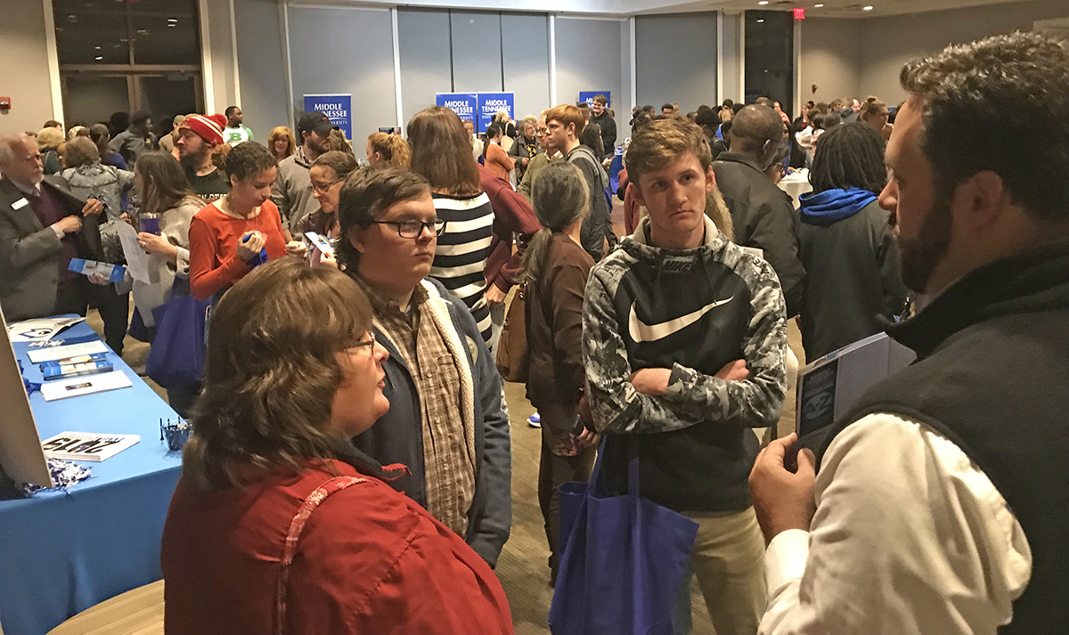 MT One Stop Director Tyler Henson, right, shares information with prospective students and families attending the annual True Blue Tour event Thursday, Nov. 7, at the Jackson Country Club in Jackson, Tenn. (MTSU photo by Randy Weiler)