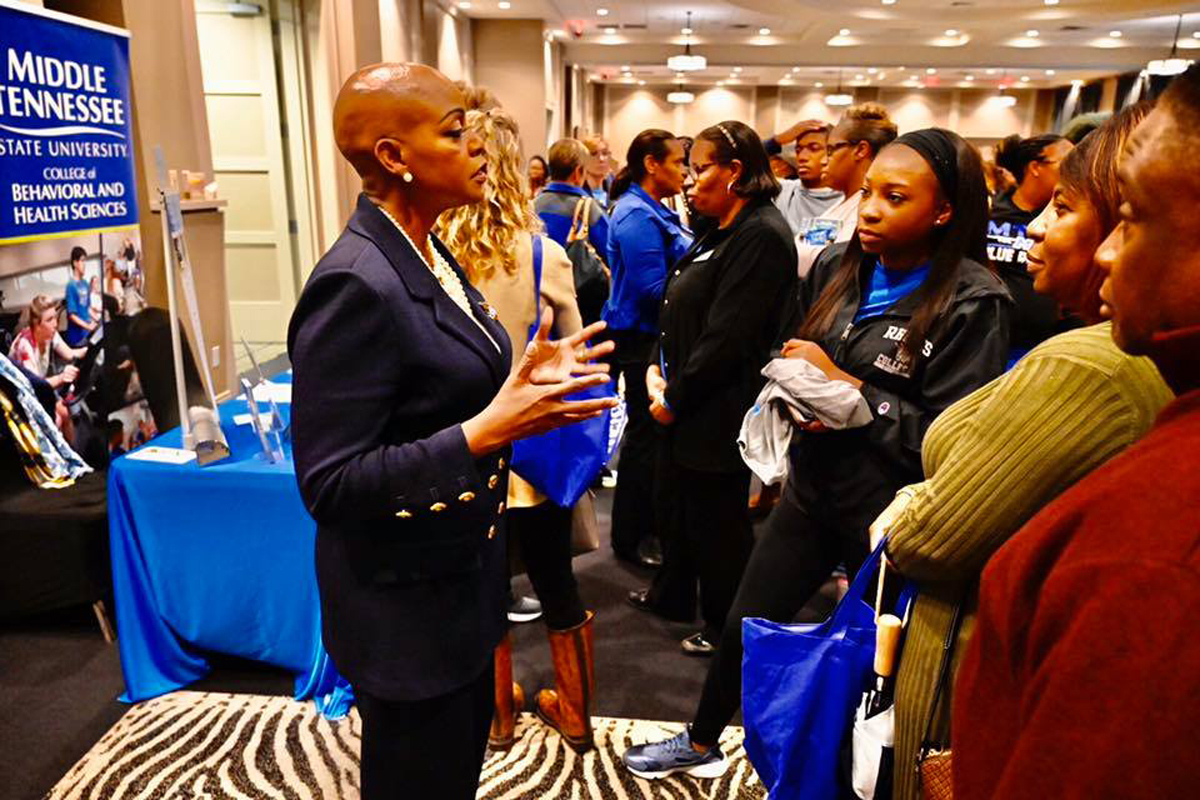 Lynda Williams, MTSU criminal justice professor and a retired U.S. Secret Service agent, talks to prospective students about the benefits of the university's program Wednesday, Nov. 6, during the True Blue Tour event at Esplande Memphis in Cordova, Tenn. (MTSU photo by Andrew Oppmann)