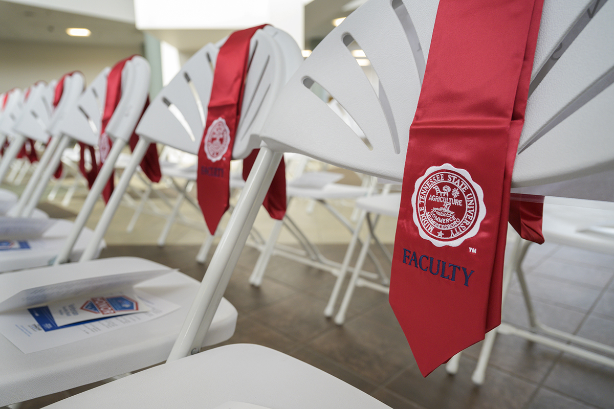 Red stoles for MTSU faculty and staff to wear during the inaugural MTSU Faculty/Staff Stole Ceremony were placed chairs for the honorees on Friday, Nov. 15, at the Miller Education Center on Bell Street. (MTSU photo by Andy Heidt)