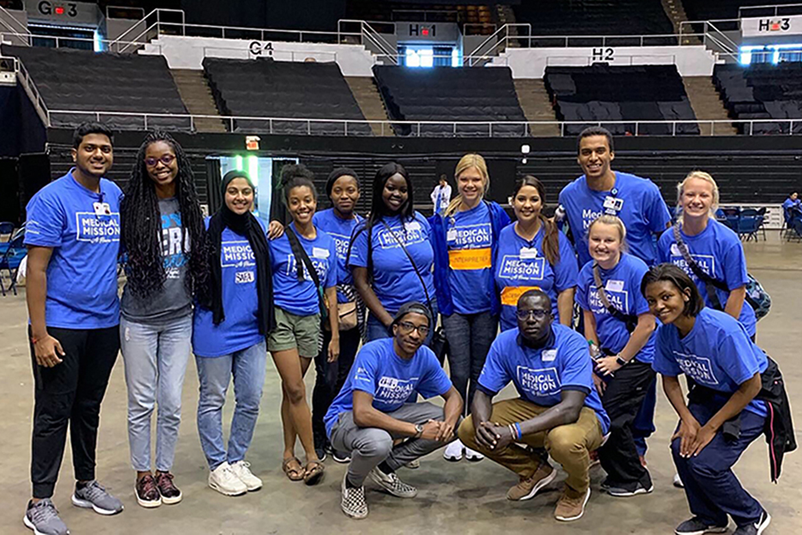Volunteers at a Medical Mission at Home pose Sept. 30 at Municipal Auditorium in Nashville. Daviesha Carter, president of the MTSU chapter of the Minority Association of Pre-Medical Students, is fourth from left in the back row. Ella Morin, president of the MTSU chapter of the American Medical Student Association, is seventh from left in the back row. (Photo provided)
