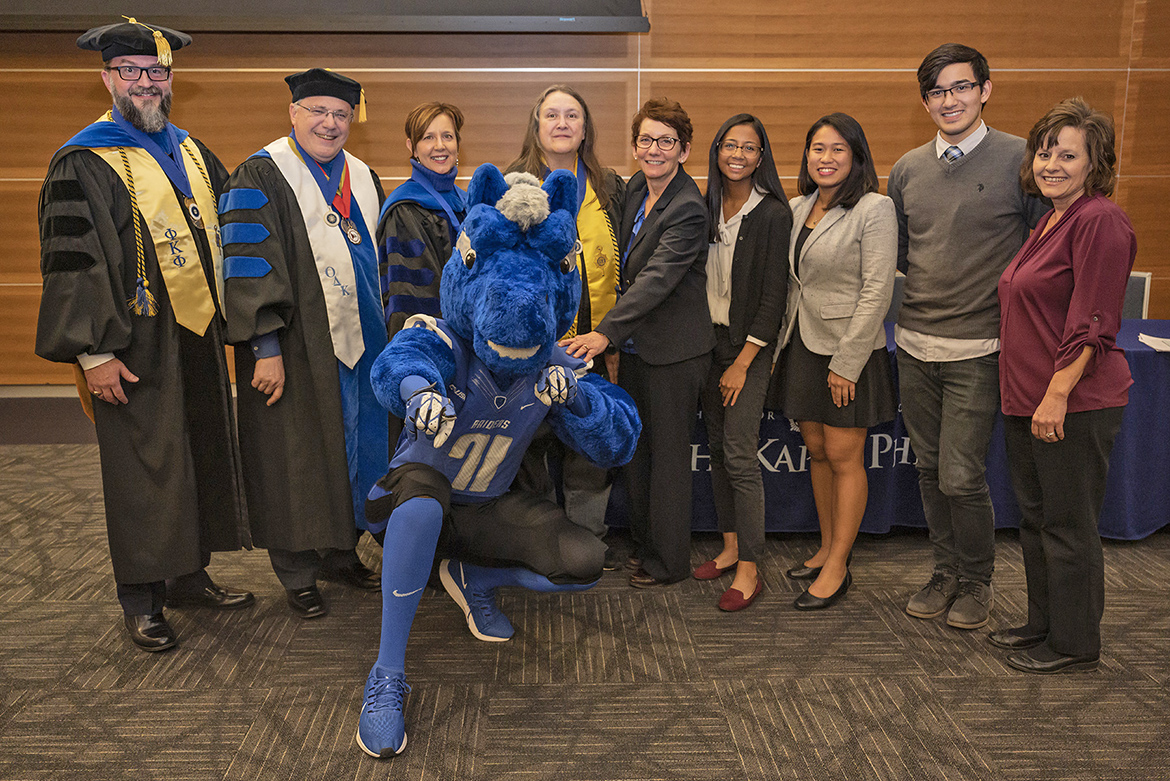 The officers of MTSU's chapter of Phi Kappa Phi pose with university mascot Lightning at the fall 2019 initiation ceremony Nov. 12 in the Student Union Building. From left, Dr. Philip Phillips, president and member of National Board of Directors; Dr. John Vile, fellowship coordinator and treasurer; Dr. Maria Bachman, president-elect; Gina Logue, secretary and public relations chair; Sandra Campbell, chapter coordinator; Jasmin Laurel, student vice president; Beatriz Dedicatoria, student vice president; Cody Maness, student vice president; and Dr. Dianna Rust, past president. (MTSU photo by Cat Curtis Murphy)
