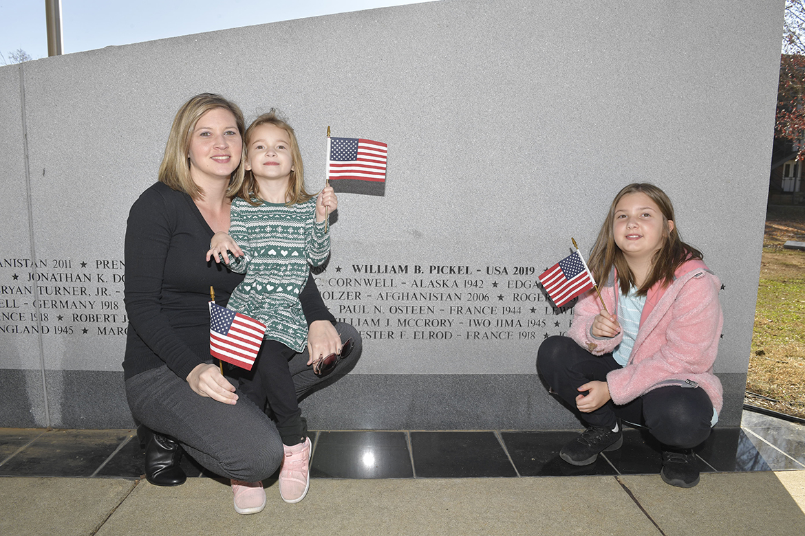 Terra Pickel, left, widow of Blake Pickel, and daughters Addalyn, 4, and Taygen, 9, posed beside his name that recently was added to the wall at the MTSU Veterans Memorial outside the Tom H. Jackson Building Saturday, Nov. 16. A memorial service kicked off activities surrounding the 38th Salute to Veterans and Armed Forces game events. (MTSU photo by James Cessna)