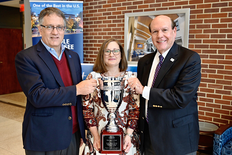 MTSU Provost Mark Byrnes, left, presents the 2019 Provost Cup to the Jennings A. Jones College of Business, represented by Teena Young, center, operations administrator for the college, and Dean David Urban. The Provost Cup is a friendly competition between academic units that is awarded to the college with the highest percentage of employee participation. The Jones College won the cup for the seventh straight year. (MTSU photo by Andrew Oppmann)