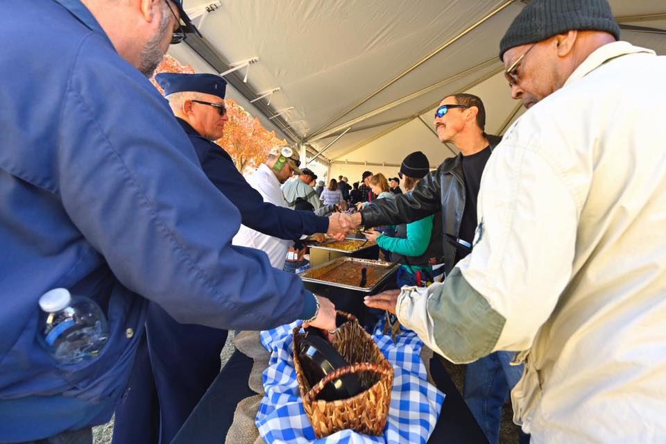 Military veterans and their families and supporters enjoy the food available at the Veterans' Picnic that was part of the activities for the 38th Salute to Veterans and Armed Forces game Saturday, Nov. 16, on the Blue Raider campus. (MTSU photo)