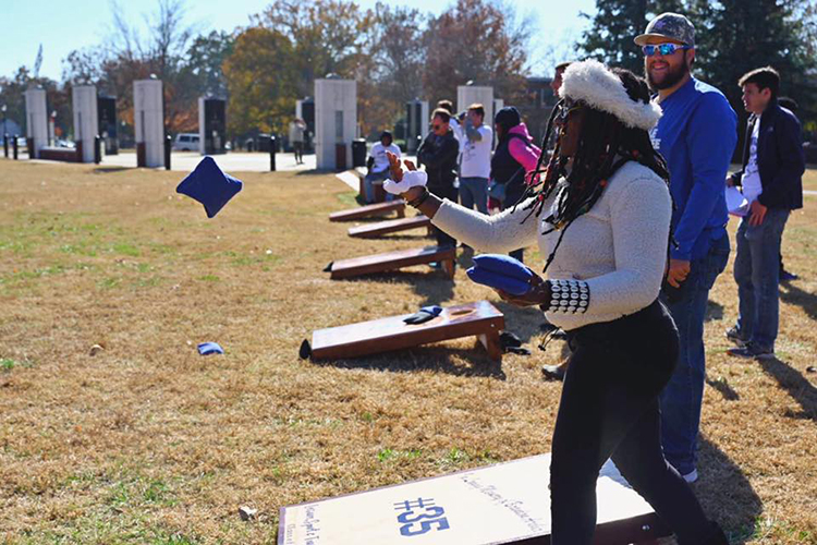 Participants enjoy a cornhole tournament fundraiser held in Walnut Grove as part of the activities for the 38th Salute to Veterans and Armed Forces game Saturday, Nov. 16, on the Blue Raider campus. (MTSU photo)