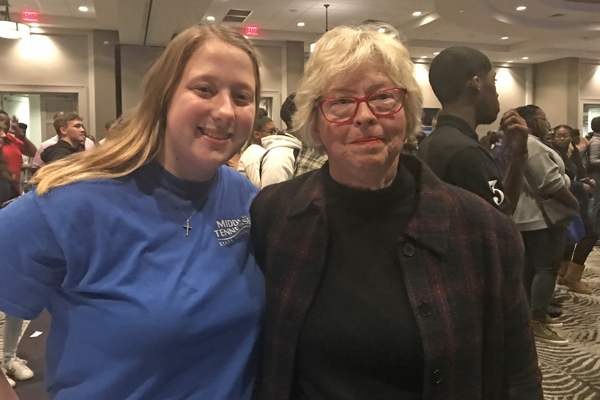 Kelly Szczepanski, left, and MTSU friend Connie Smith, regional director with AdvancED/Cognia, posed after Smith provided a $4,000 scholarship to the aspiring special education teacher Wednesday, Nov. 6, at the True Blue Tour event at Esplande Memphis in Cordova, Tenn. (MTSU photo by Randy Weiler)