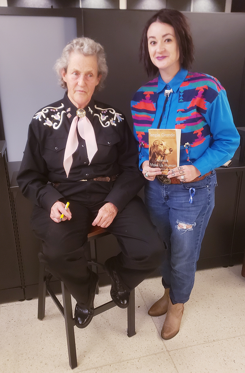 "Because of the research in both animal science and autism by Temple Grandin, left, MTSU junior pre-vet major Caitlin Thompson became an admirer and met her hero Monday, Nov. 11, during Grandin's appearance at sold-out Tucker Theatre. Thompson, who has read Grandin's book, ""Animals Make Us Human,"" several times, was one of dozens who received an autograph and had their photo taken with the lecturer. (Submitted photo)"