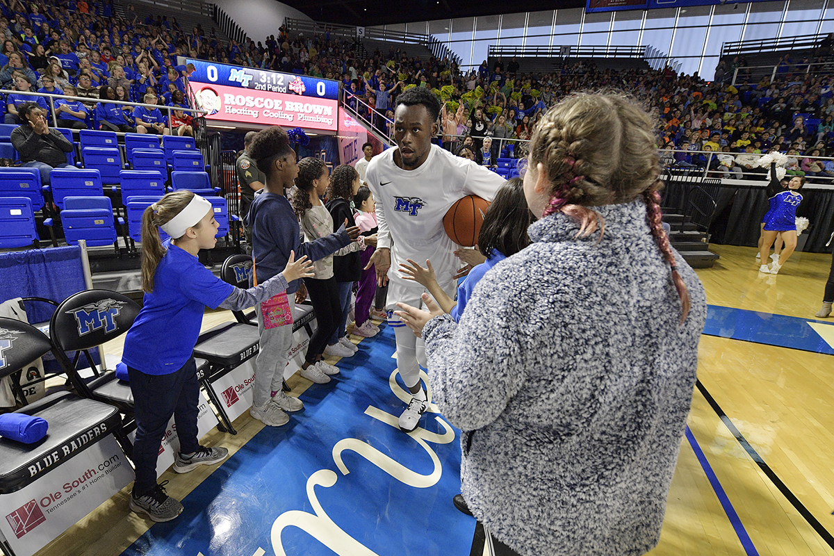 Rutherford County Schools' fifth-graders welcome MTSU men's basketball players onto the court as part of the pregame events during Rutherford County Schools' Day at MTSU. The Blue Raiders defeated Maryville College, 119-61. (MTSU photo by Andy Heidt)