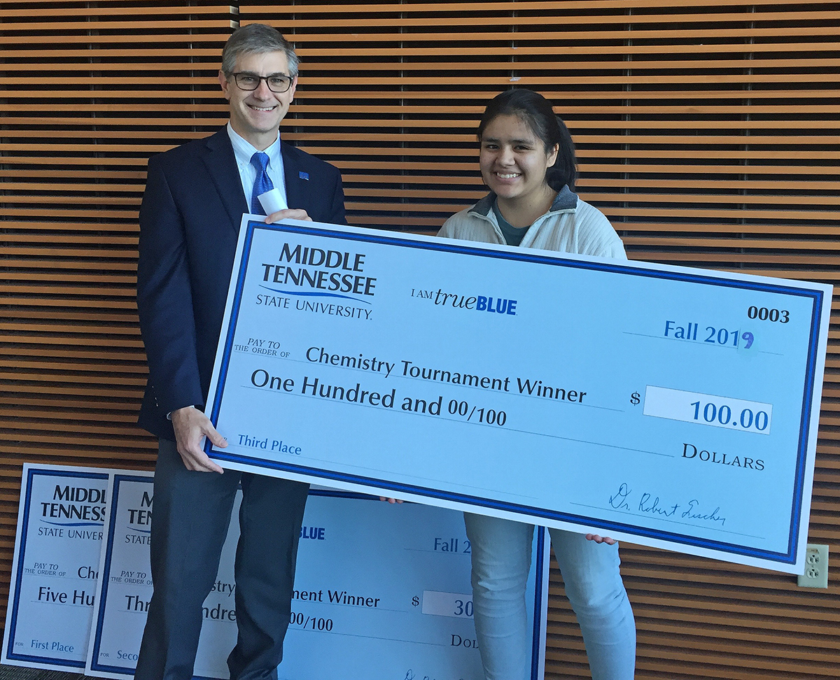 MTSU Department of Chemistry Chair Greg Van Patten, left, awarded Lizbeth Lozano a $100 cash prize for being the top junior winner in the 2019 Chemistry Scholarship Tournament, held in the Science Building on campus. Lozano is a student at Central Magnet School in Murfreesboro. (Submitted photo)