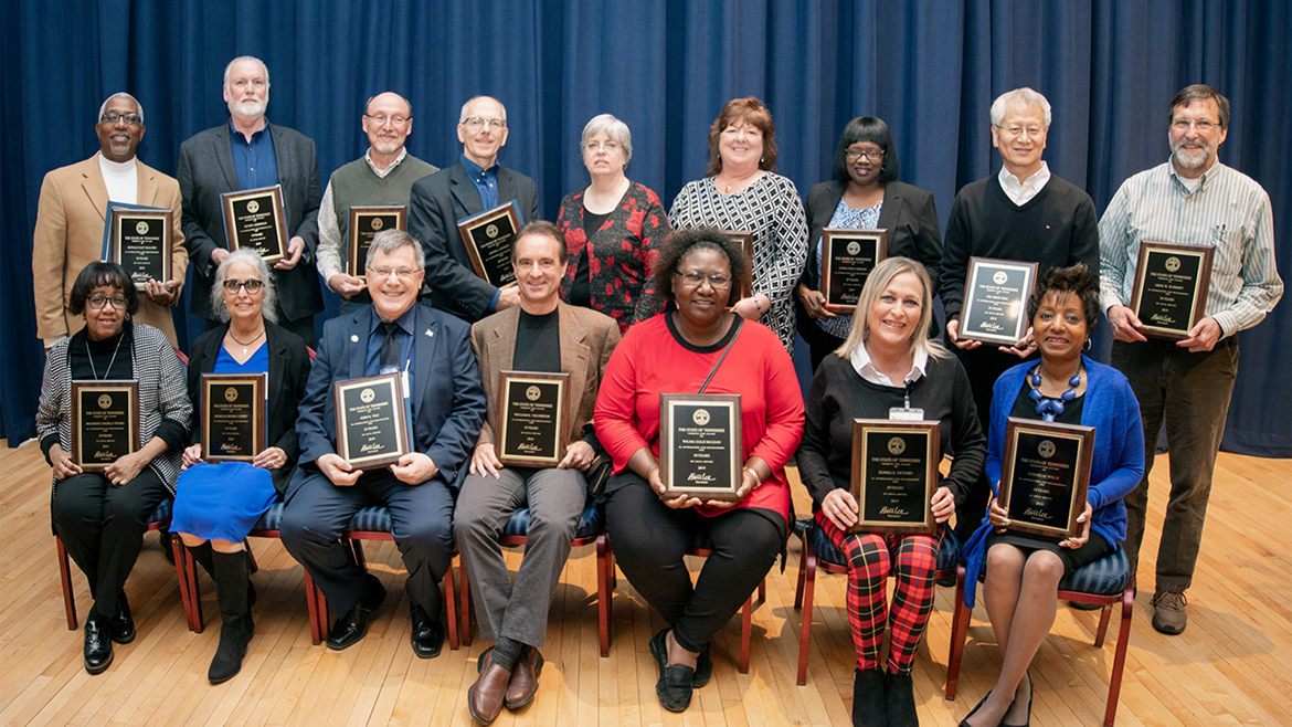 MTSU employees honored for 30 years of service to the university pose with plaques recognizing their work at the university's annual Service Award Luncheon, held Dec. 5 in the James Union Building. More than 230 faculty and staff members were saluted at the 2019 event for their years of service. Seated on the front row are, from left, Maureen Young of Murfreesboro, Office of International Affairs; Denise Cathey of Rockvale, Tenn., School of Journalism and Strategic Media; John Vile of Murfreesboro, University Honors College; Bill Yelverton of Murfreesboro, School of Music; Gale McLean of Murfreesboro, James E. Walker Library; Donna Victory of Murfreesboro, Registrar's Office; and Cornelia Wills of Nashville, Office of the Vice Provost for Student Success. Standing from left are Ron Malone of Murfreesboro, Events and Transportation Services Department; Kevin Donovan of Murfreesboro, Department of English; Greg Hunt of Manchester, Tenn., WMOT Radio; David Loucky of Murfreesboro, School of Music; Joyce Reed of Murfreesboro, Facilities Services Department; Phyllis Kitzler of Murfreesboro, Information Technology Division; Linda Jordan of Murfreesboro, Facilities Services; Jwa Kim of Murfreesboro, Literacy Studies Ph.D. Program; and Greg Schmidt of Murfreesboro, Department of Psychology. (MTSU photo by James Cessna)