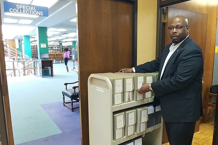 MTSU alumnus Brandon Owens is shown on the job as assistant librarian for technical services at the John Hope and Aurelia E. Franklin Library at Fisk University in Nashville, Tennessee. Owens is a graduate of MTSU's Master of Library Science online program. (Photo courtesy of Clarke Bagsby/Fisk University)