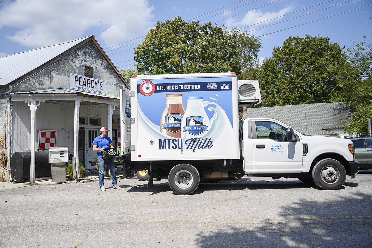 MTSU junior agriculture major Brendon Puckett delivered MTSU Creamery milk to Pearcy's General Merchandise in Lascassas, Tenn., on stop earlier this fall. Pearcy's is one of 15 businesses in three counties carrying MTSU milk products. (MTSU photo by J. Intintoli)