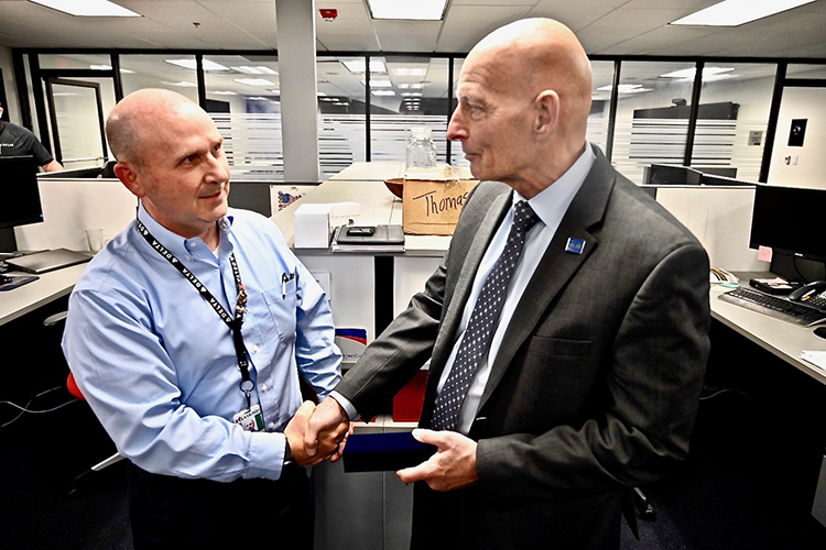 Kurt Robinson, Delta's manager for quality control and receiving inspection and president of the airline's veterans group, presented retired Army Lt. Gen. Keith Huber, MTSU's senior advisor for veterans and leadership initiatives, with a replica of Delta's pilot wings, embossed with the five service seals of the armed forces, to honor Huber's commitment to veterans. (MTSU photo by Andrew Oppmann)