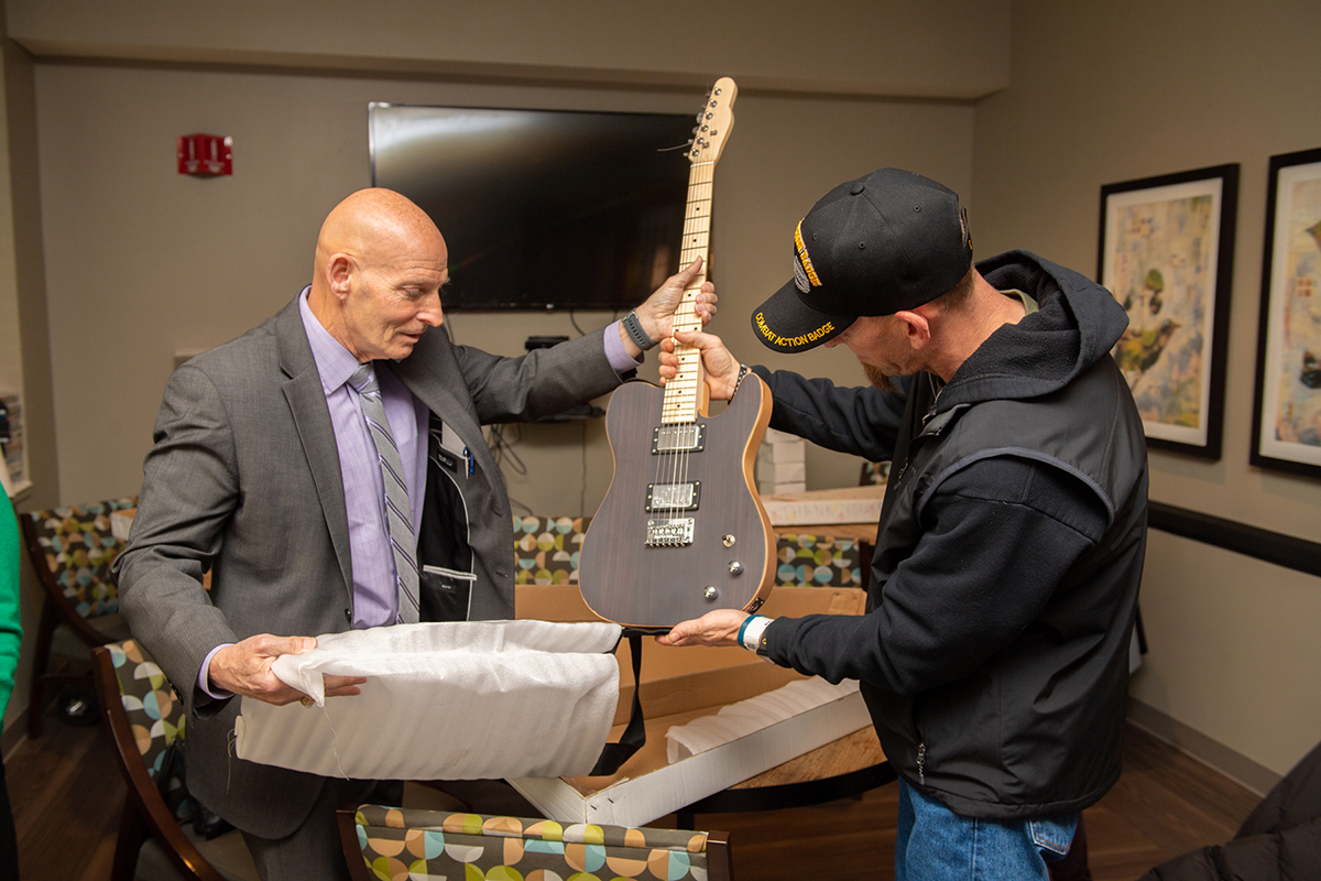 MTSU's Keith M. Huber, left, and patient Levi Troxell inspected the first of four electric guitars given by Schneider Electric and MTSU to the Alvin C. York Veterans' Administration Medical Center for music therapy. A 38-year U.S. Army veteran and retired lieutenant general, Huber is the senior adviser for veterans and leadership initiatives at MTSU. (MTSU photo by James Cessna)