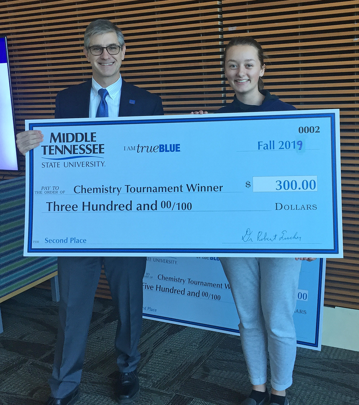 MTSU Department of Chemistry Chair Greg Van Patten, left, presented Sydney Coil with a $1,500 scholarship and $300 cash prize for finishing runner-up in November in the 2019 Chemistry Scholarship Tournament in the Science Building. Coil is a senior at Independence High School in Thompson's Station, Tenn. (Submitted photo)