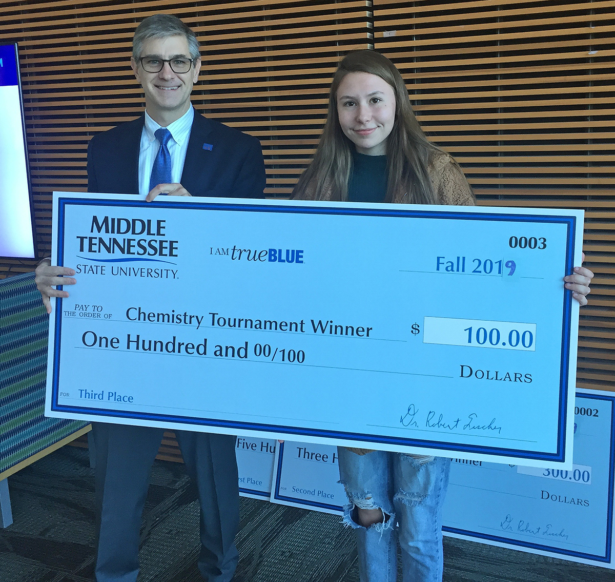 Independence High School senior Lauren Caldwell, right, recently received a $1,000 MTSU chemistry scholarship and $100 cash prize from department Chair Greg Van Patten for placing third in the recent Chemistry Scholarship Tournament in the Science Building. (Submitted photo)
