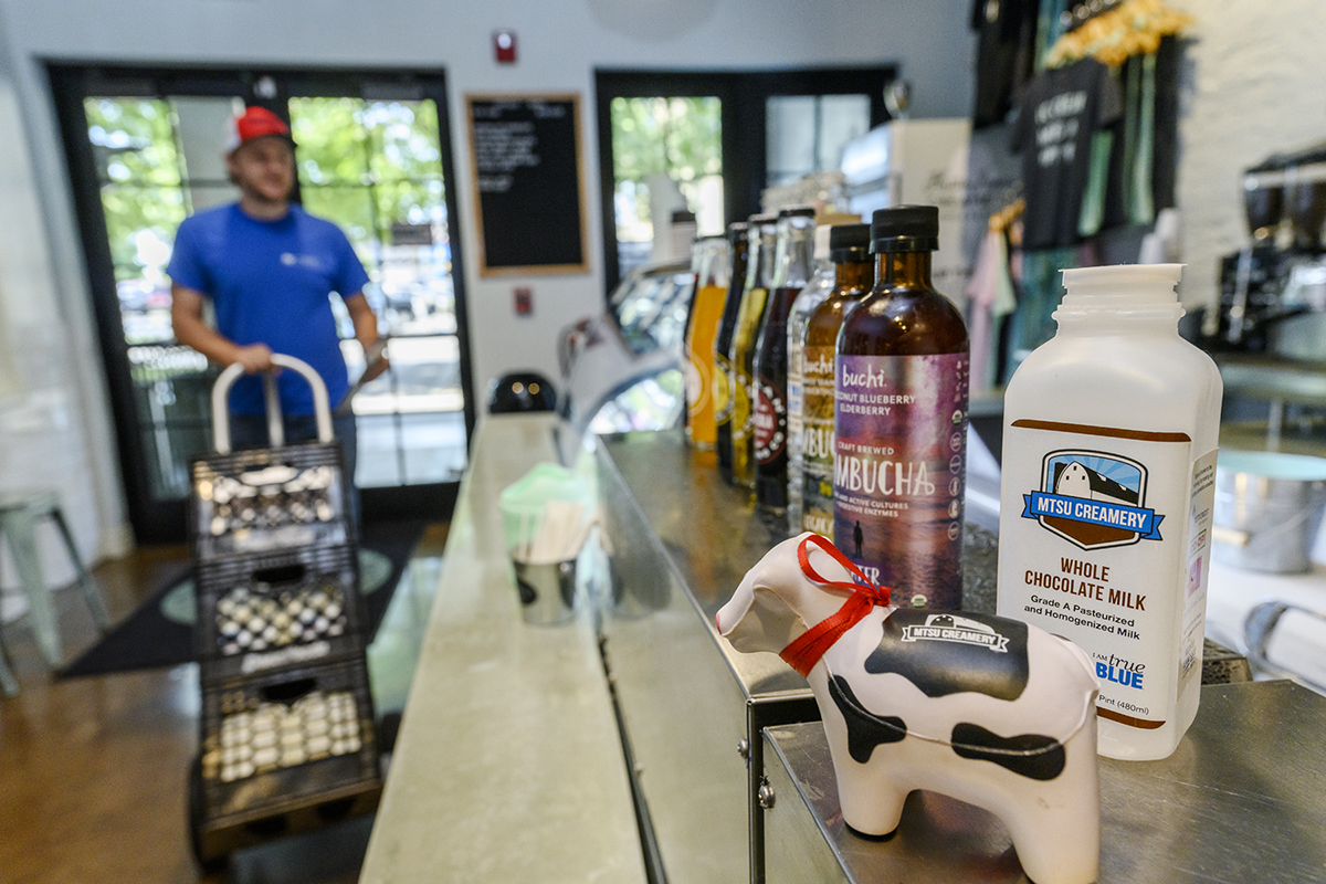 MTSU junior agriculture major Brendon Puckett made a delivery of chocolate and white milk to Hattie Jane's Creamery in downtown Murfreesboro. The marketing of a tin sign is helping increase awareness of the product and participation in the Tennessee Milk program. (MTSU photo by J. Intintoli)