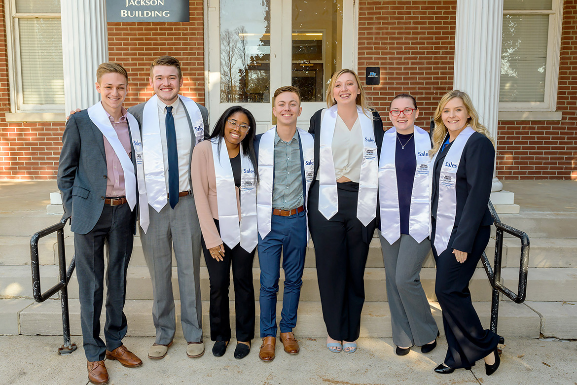 MTSU's Department of Marketing Professional Selling Concentration held its inaugural Stole Ceremony on Nov. 19 at the Tom H. Jackson Building for graduating students who enrolled in the new concentration within the Jones College of Business. Pictured, from left, are students Caleb (Tate) Huffman, Drew Christiansen, Faith Rodgers, Forrest Mason, Kayli Jones, Christine Owens and Amanda Post. (MTSU photo by Andy Heidt)
