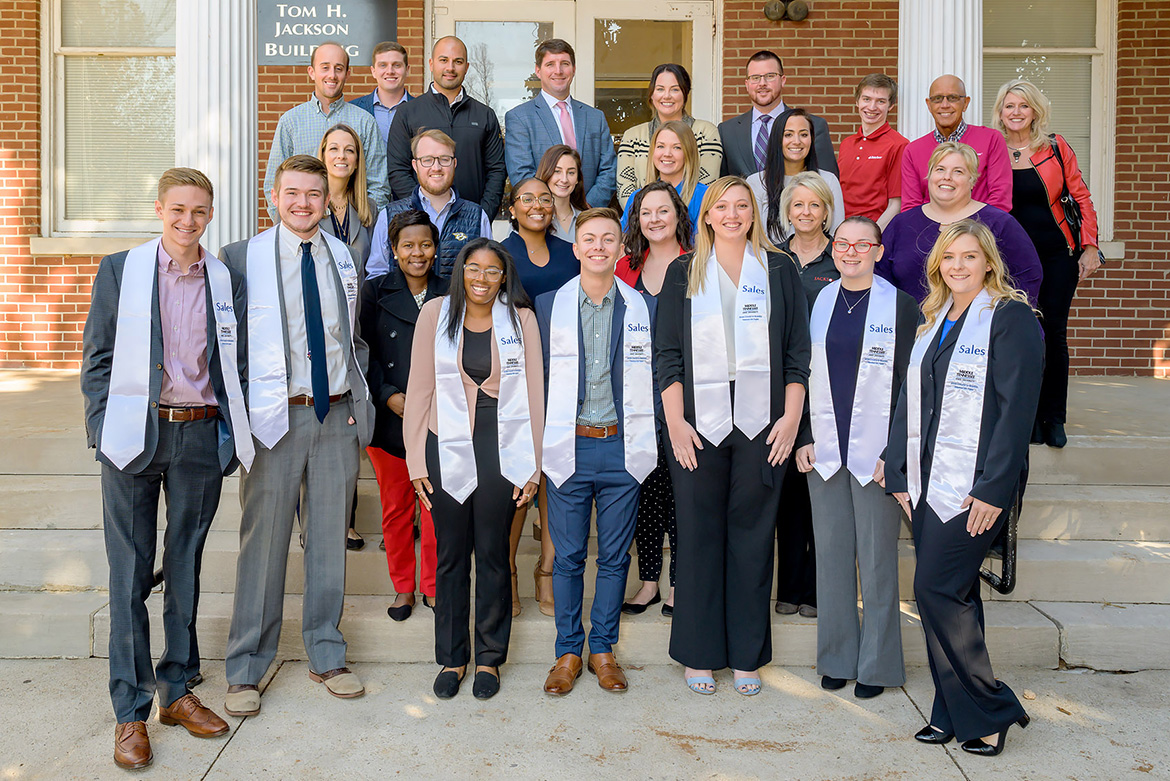 Graduating students from the Department of Marketing's Professional Selling Concentration, front row wearing white stoles, are pictured with current corporate sponsors and sales faculty following the Nov. 19 inaugural stole ceremony for the concentration inside the Tom H. Jackson Building. (MTSU photo by Andy Heidt)
