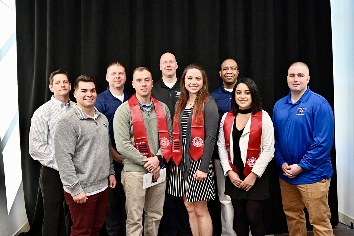 MTSU military science faculty members joined three ROTC students who received red stoles at the 15th Graduating Veterans Stole Ceremony Wednesday, Dec. 4, at the Miller Education Center on Bell Street. From left are Maj. Trint Callison, Capt. Alex Rodriguez, Sgt. 1st Class James Plack, Ethan Roberts, Master Sgt. Jay Farmer, Rachel Teufert, Capt. LaShawn Wilson, Neily Jimenez and Capt. Derrick Gessler. The cadets can wear the stoles at the Dec. 14 commencement ceremonies in Murphy Center. (MTSU photo by J. Intintoli)