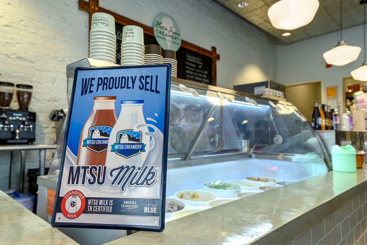An 11 x 17-inch tin sign in Hattie Jane's Creamery in downtown Murfreesboro helps promote the MTSU Creamery and MTSU milk, which is a Tennessee Milk 100 percent locally produced product. (MTSU photo by J. Intintoli)