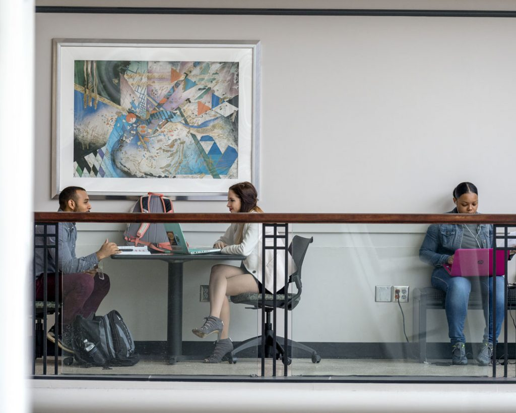 Study partners collaborating in James E. Walker Library. Photo by J. Intintoli.