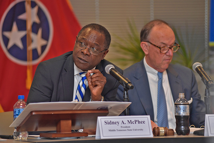 MTSU President Sidney A. McPhee makes a point about the university's efforts to build strategic partnerships with business and industry during the university's Board of Trustees meeting held Tuesday, Dec. 10, in Miller Education Center on Bell Street. At right is board Chairman Stephen Smith. (MTSU photo by James Cessna)