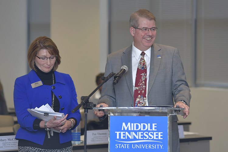 MTSU's Joe Bales, right, vice president for university advancement, and Paula Leslie, director of partnerships and strategic planning, update the Board of Trustees on efforts to build strategic business and industry partnerships during the board's quarterly meeting held Tuesday, Dec. 10, at the Miller Education Center. (MTSU photo by James Cessna)