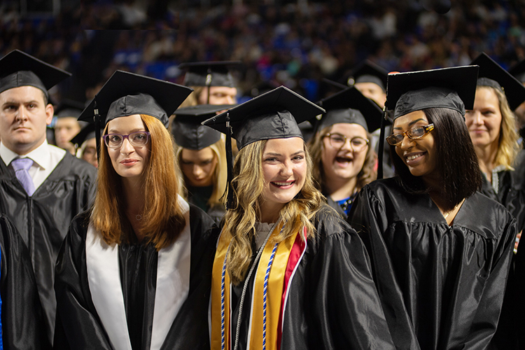 Happy members of MTSU's Class of 2019 await the university's morning commencement ceremony inside Murphy Center on Saturday, Dec. 14. (MTSU photo by James Cessna)