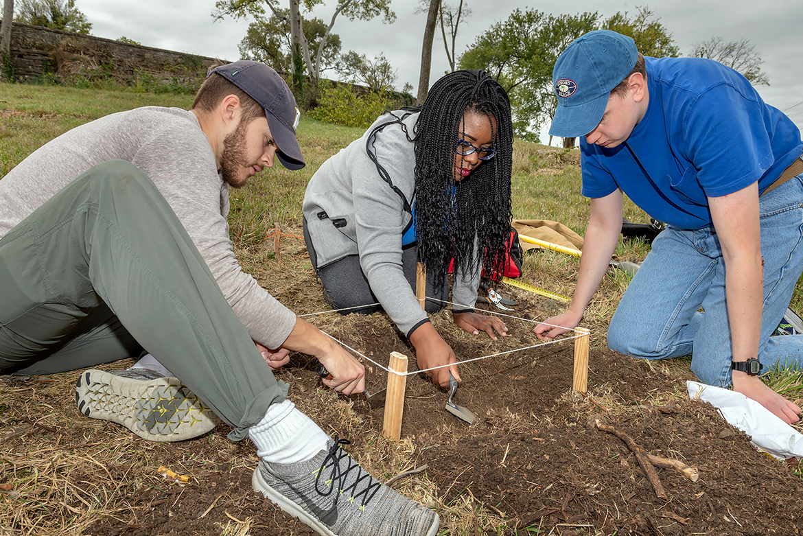 MTSU students work in one of the archaeological units during an Oct. 19, 2019, dig at the Bass Street Community Archaeology Project in Nashville. Pictured, from left, are Joshua Shell, Jasmine Elliott and Noah Seifert. (MTSU photo by James Cessna)