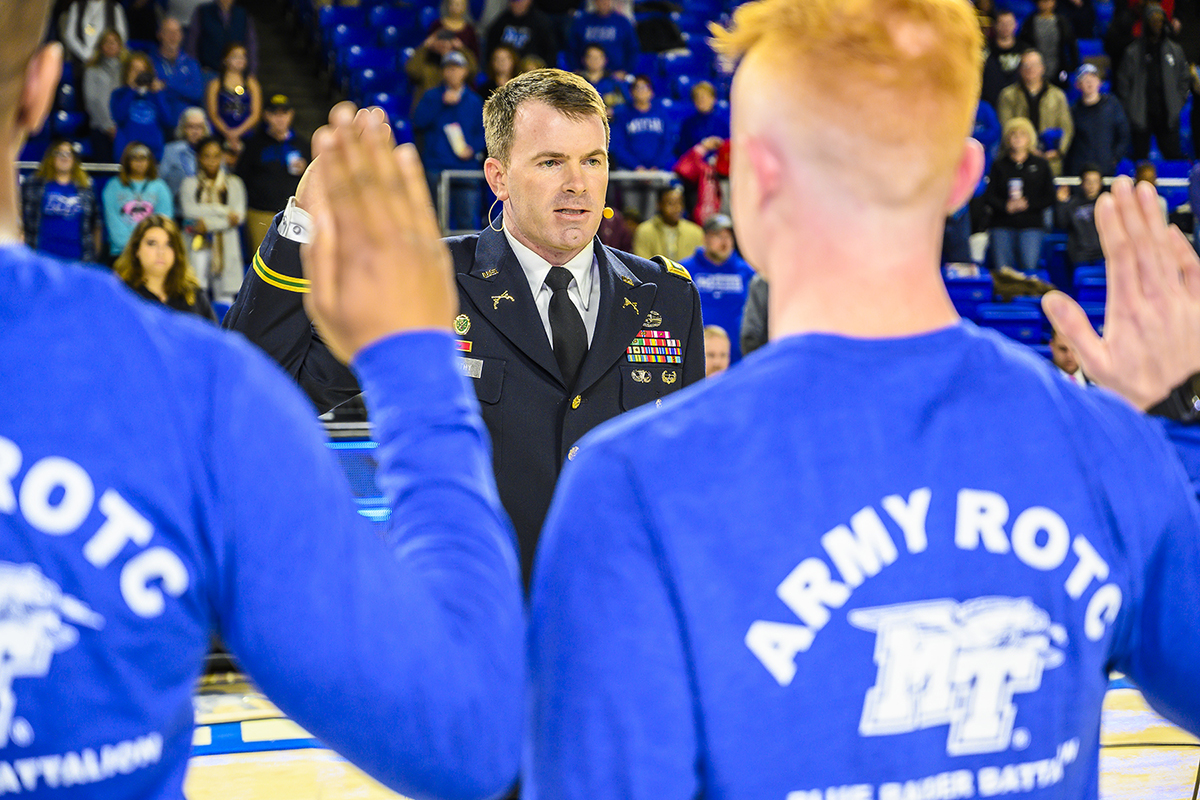 U.S. Army Lt. Col. Carrick McCarthy, center, administers the Army oath, to new MTSU ROTC students in January 2019 as part of the first Blue Raider Veteran and Military Appreciation Night in January 2019. This year's veterans game will be at 6:30 p.m. Thursday, Jan 30, in Murphy Center. (MTSU file photo by Eric Sutton)