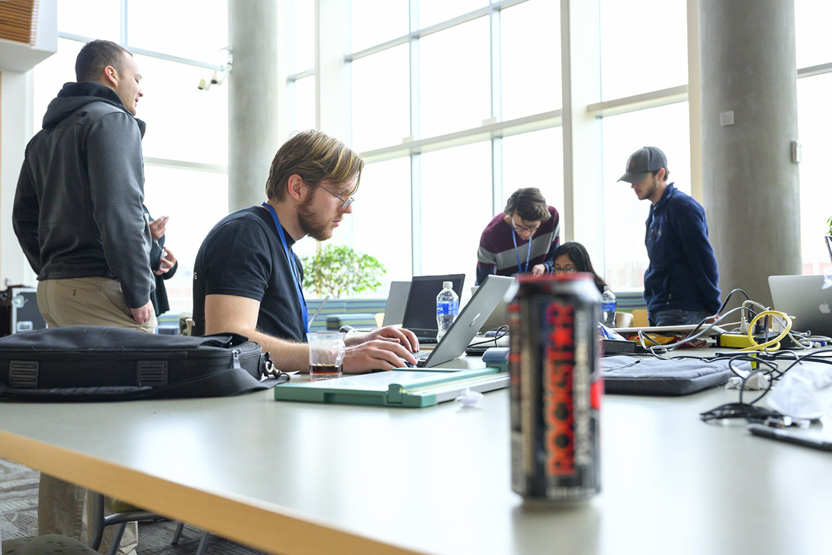 One of the teams in the fifth annual HackMT at MTSU collaborates to apply the finishing touches to its project just before the judged science fair portion of the event Sunday, Jan. 26, in the Science Building's second-floor atrium. (MTSU photo by Cat Curtis Murphy)