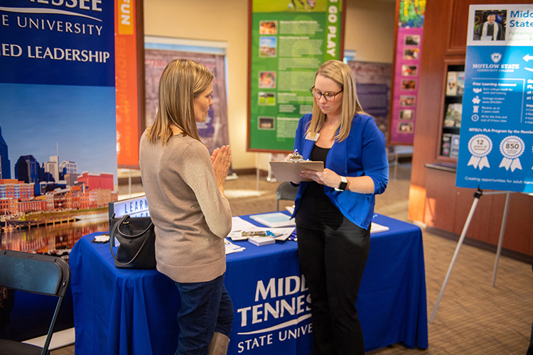 An MTSU University College staffer answers questions at a Finish Your Degree Q-and-A event for prospective students in late October at the Rutherford County Chamber of Commerce in Murfreesboro, Tenn. The college will hold a similar event Feb. 6 at the D.W. Wilson Community Center in Tullahoma. It is free and open to the public. (MTSU file photo by James Cessna)